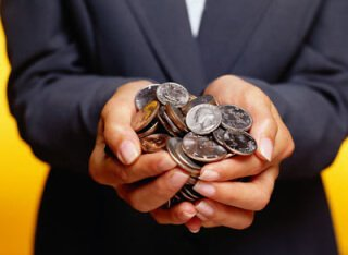 hands holding a pile of coins
