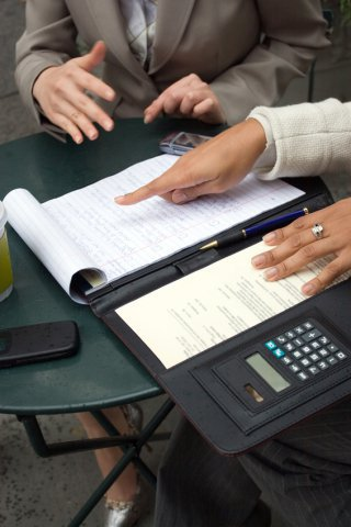 Two people reviewing business documents