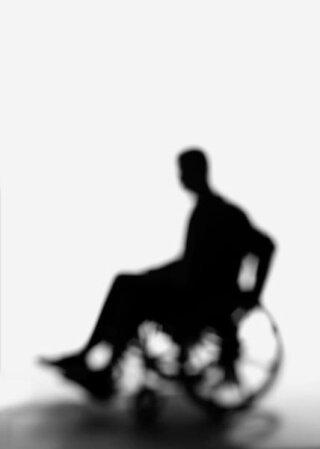 silhouette of person in chair