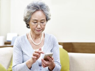 elderly woman looking at a cell phone