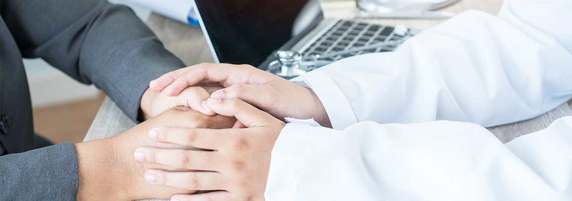 Doctor Hands Holding Patient with Friendly Encouragement and Empathy