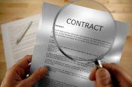 magnifying glass over contract