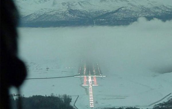 Foggy Runway in front of a mountian