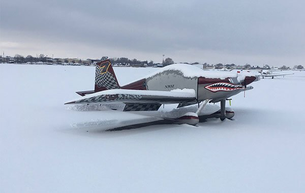 Plane with an angry face in the snow