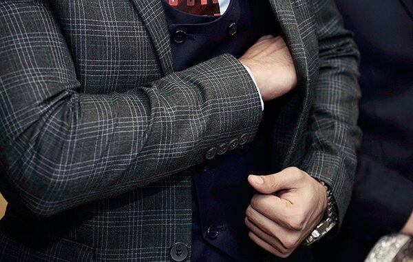Businessman reaching into his suit jacket pocket