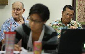 Attorney William Harrison sitting with an elderly client