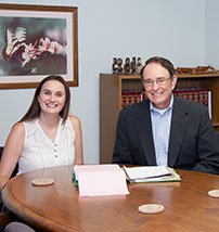 Paralegal Lacey Perez and Attorney John Stuart