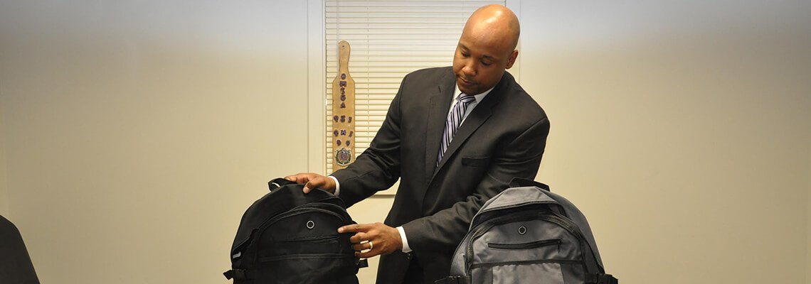 Attorney Frank Walker with Backpacks