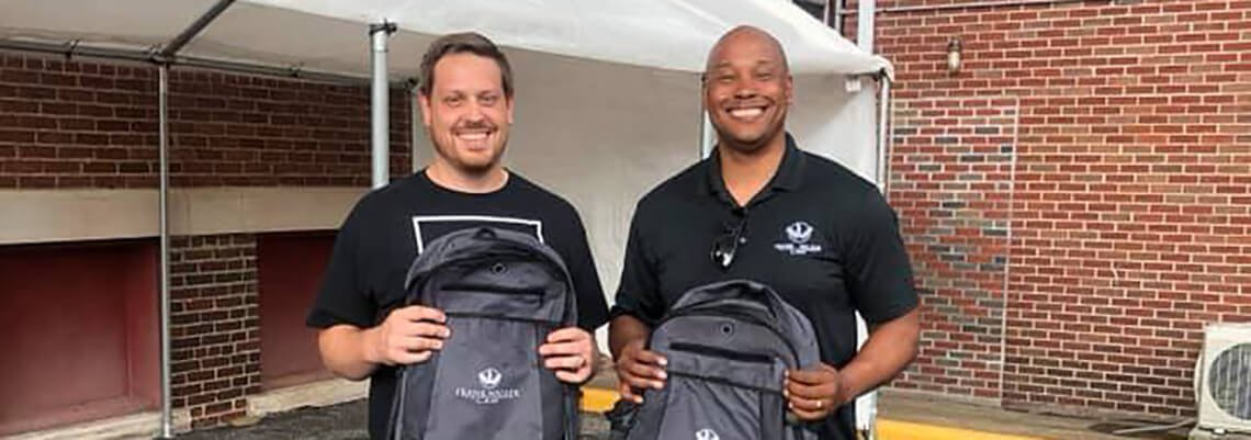Attorney Frank Walker and Pastor Brandon with Backpacks