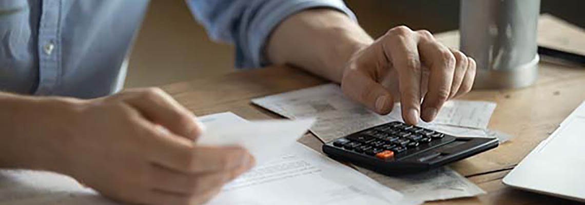 Man working with a calculator