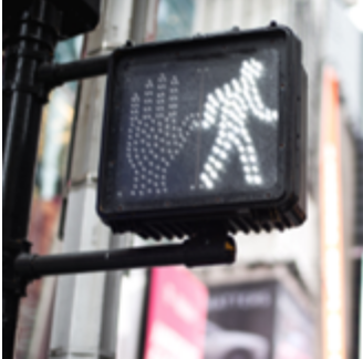 MAKING TRAFFIC SIGNALS FAIR FOR PEDESTRIANS