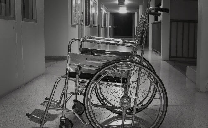 Wheelchair in hospital hallway