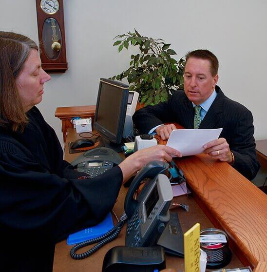 Attorney going over papers with paralegal