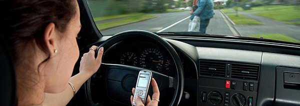 Woman texting and driving