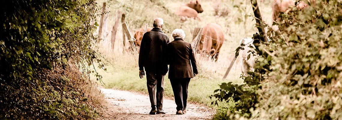 Older couple walking away