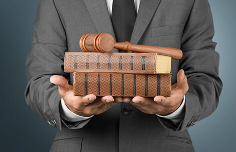 Businessman with books and gavel