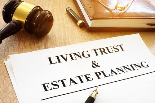 Document with living trust and estate planning on it