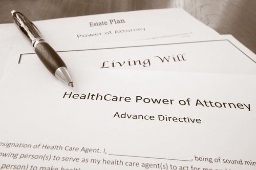 Pen on documents depicting power of attorney