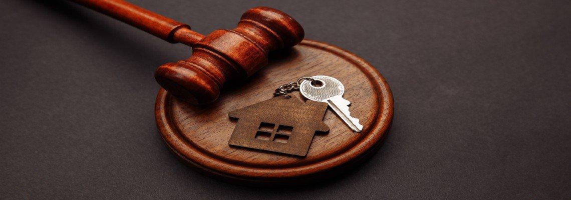 Gavel resting near house keys