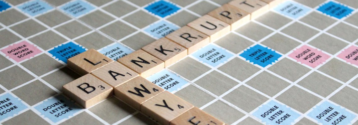 The Word Bankruptcy and the Word Attorney Spelled Out in Scrabble Tiles.jpg
