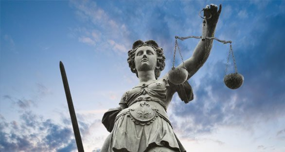 Scales of Justice in Front of Clouds