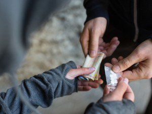 Pills Being Exchanged for Cash