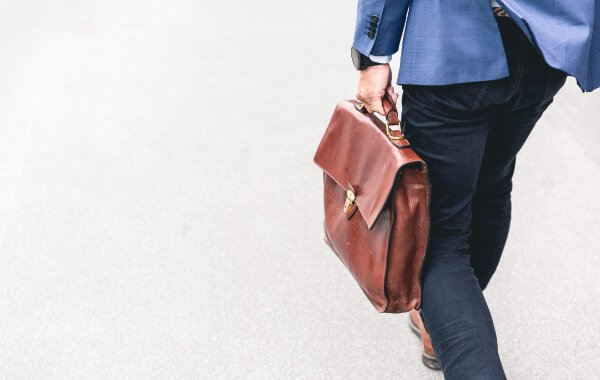 Attorney walking with a briefcase