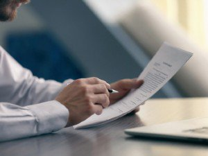 Man in Dress Shirt Reviewing a Document