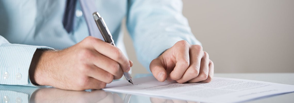 Attorney signing a document