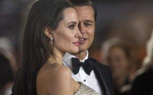 Angelina blocking picture of Brad Pitt.
